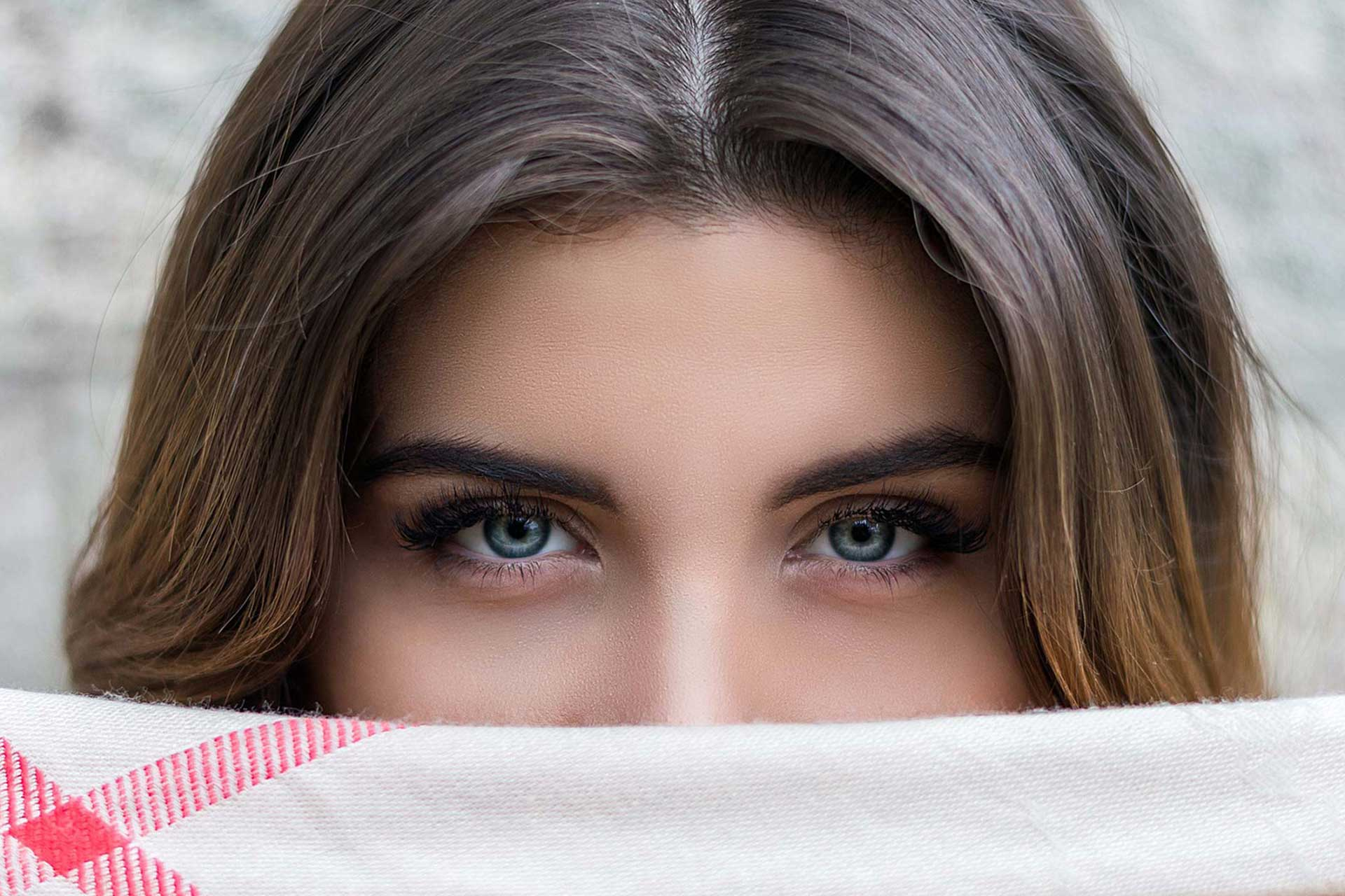 beautiful eyes woman mouth covered